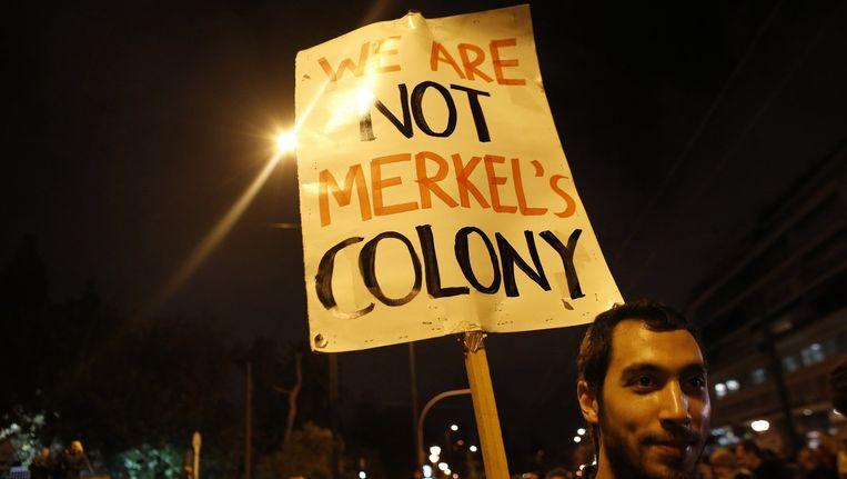 """""""Wij zijn niet de kolonie van Merkel"""", stond er op de plakkaat van deze Griek."""