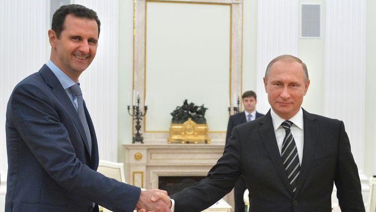 Assad op bezoek bij Poetin. Beeld .