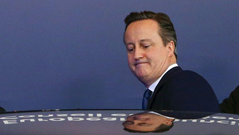 De Britse premier David Cameron verlaat de EU-top van 20 februari in Brussel. Beeld REUTERS