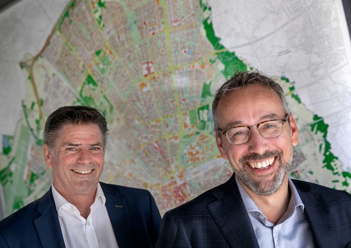 Wethouder Jan van der Meer en directeur Frans van Strijp van afvallinzamelaar Cure.