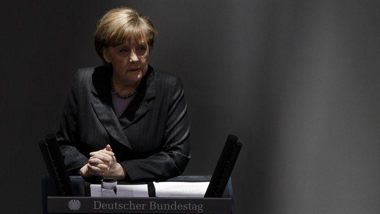 Merkel spreekt het Duitse parlement toe. Beeld reuters