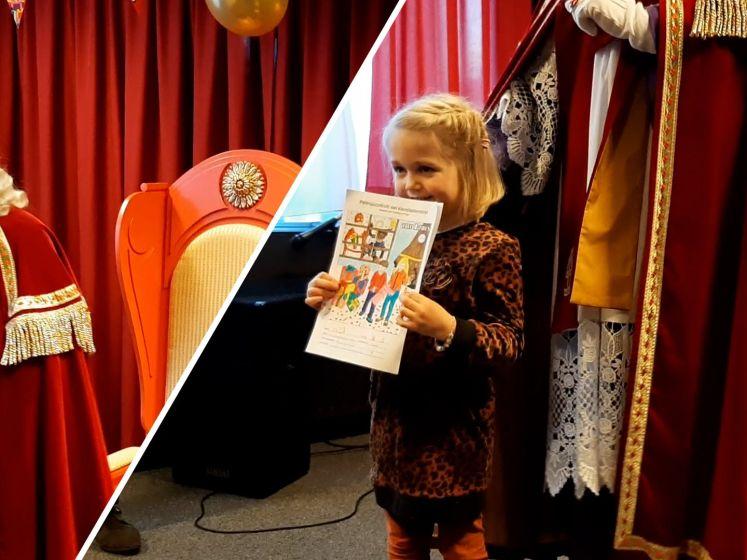 Sinterklaas deelt cadeau's uit voor kleurplaten in Almelo