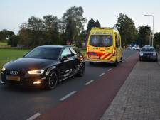 Audi ramt auto die achteruit weg oprijdt in Groesbeek: bestuurder naar ziekenhuis
