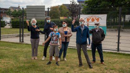 Vluchtelingenwerkgroep Wetteren heet iedereen welkom met klavertjesmondmasker