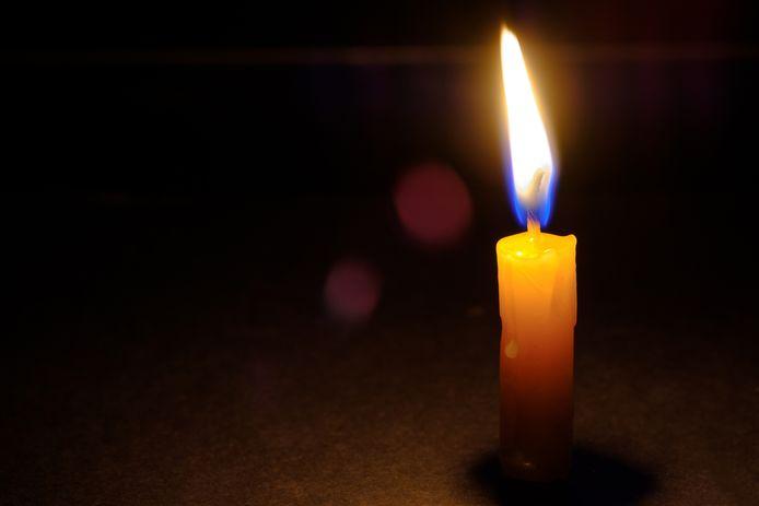 Light candle burning brightly with night background. Kaarsje, overlijden, overleden, overlijdensbericht stock