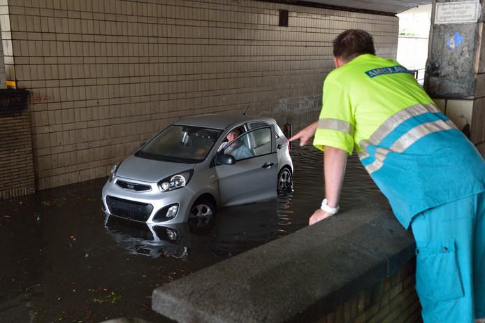 Foto Pim Mul 28072014 Gouda. Spoorstraat Wateroverlast tijdens hevige regenval. Bestemd voor ADGH