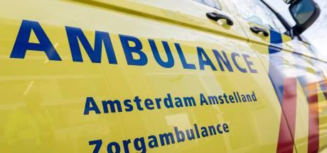 Vrouw in scootmobiel te water geraakt bij Westerdoksdijk
