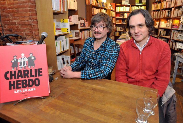 Cartoonisten Luz (links) en Riss (rechts) van Charlie Hebdo.