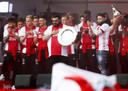 De spelers van Ajax op het podium samen met vader Mohammed Nouri en broer Abderrahim  tijdens de huldiging op het Museumplein. Ajax heeft voor de 34e keer de landstitel gewonnen.