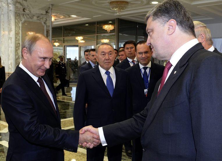 Archiefbeeld van de Russische president Vladimir Poetin en zijn Oekraïense ambtgenoot Petro Porosjenko.