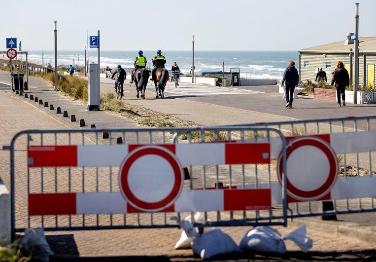 Toelatingsbeleid op het strand wordt wellicht voorlopig het nieuwe normaal. Beeld ANP