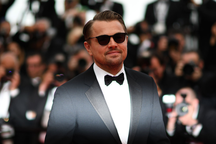 "US actor Leonardo DiCaprio poses as he arrives for the screening of the film ""Ice on Fire"" at the 72nd edition of the Cannes Film Festival in Cannes, southern France, on May 22, 2019. (Photo by Christophe SIMON / AFP)"