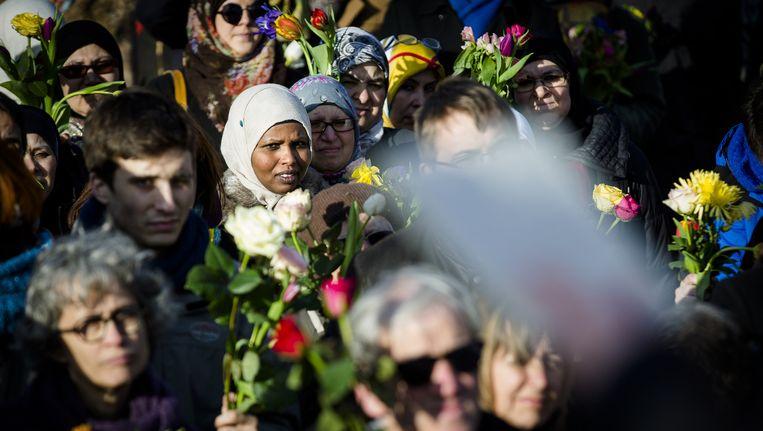 Joden en moslims luisteren naar een spreker tijdens een solidariteitswandeling, februari dit jaar Beeld anp