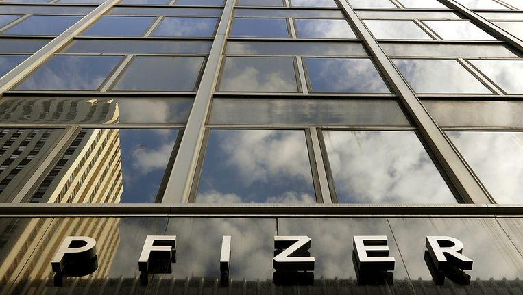 Het logo van medicijnenfabrikant Pfizer. Beeld afp