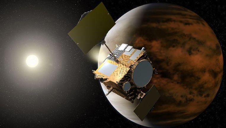 Artistieke impressie van ruimtesonde 'Akatsuki' (zonsopkomst) in een baan rond Venus. In de werkelijkheid is het nooit zo ver gekomen. Beeld afp