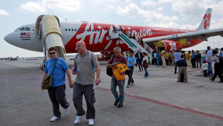 Een vlucht van Air Asia uit Londen is net geland in Kuala Lumpur. Volgens de topman van de maatschappij zitten er meer budgetvluchten van Europa naar Azië in het vat. Beeld epa