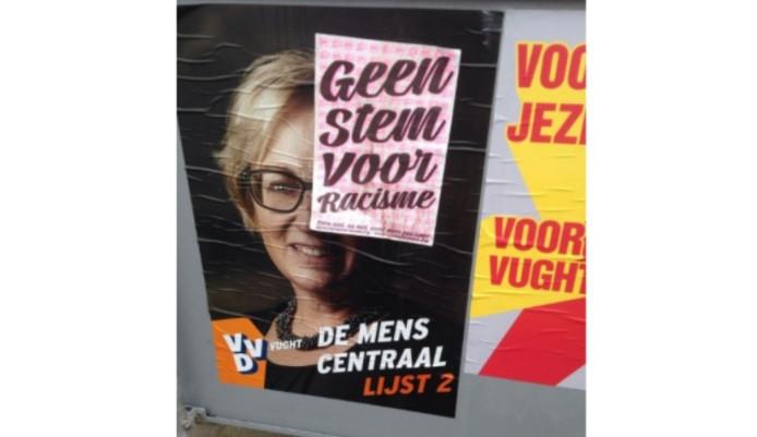 Verkiezingsposter VVD Vught beplakt