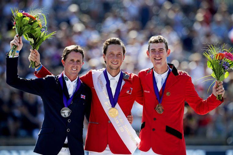 Verlooy (r) naast winnaar Martin Fuchs en zilveren Ben Maher (l).