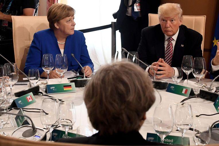 Merkel en Trump bij een werklunch tijdens de G7-top in Taormina. Beeld afp