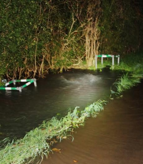Dorpsweg bij Biert onder water gelopen
