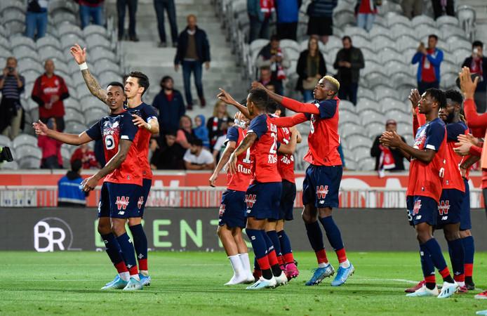De spelers van Lille vieren feest.