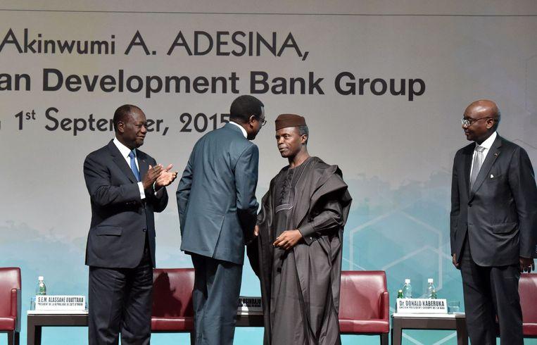 Akinwumi Adesina (tweede links) werd op 1 september benoemd tot nieuwe president van de African Development Bank. Beeld anp