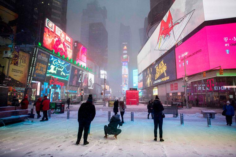 De eerste sneeuw in New York, vanmorgen op Times Square.