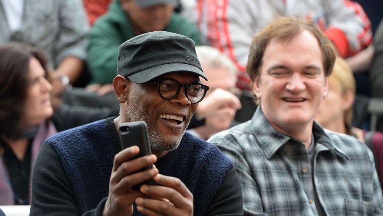 Acteur Samuel L Jackson naast regisseur Quentin Tarantino. Beeld AFP