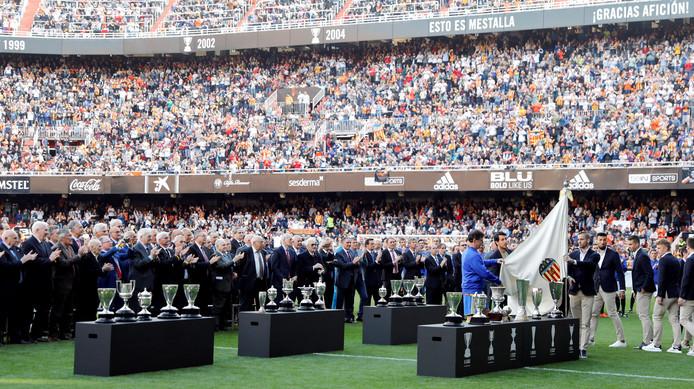 epa07460766 Valencia CF's captain Dani Parejo (7-R) reacts during the celebration of the Valencia CF's centenary held at Mestalla stadium, in Valencia, eastern Spain, 24 March 2019.  EPA/Kai Foersterling
