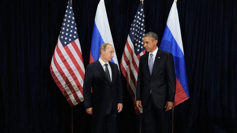 President Valdimir Poetin en president Barack Obama in New York op 28 September 2015. Beeld epa