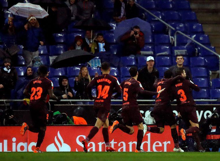 Vreugde bij Barça na de late gelijkmaker van Piqué.