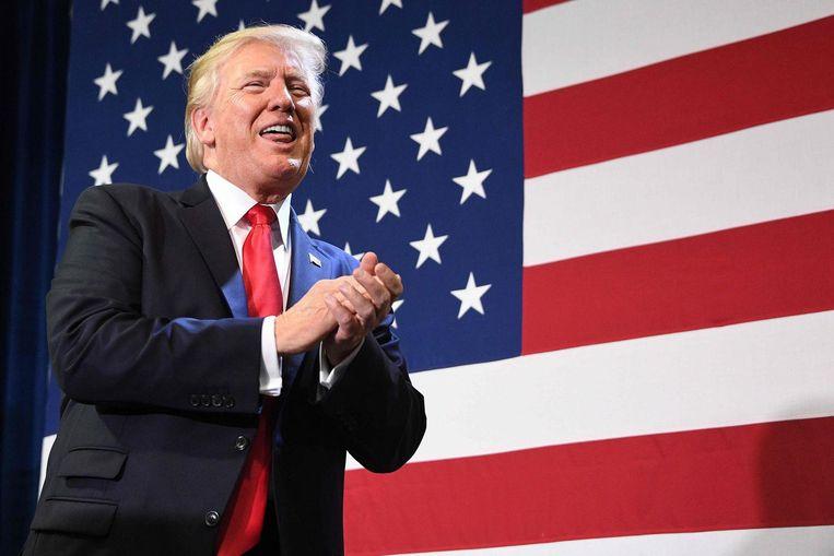President Trump bezocht woensdag een fabriek in Missouri om zijn belastinghervormingsplannen te presenteren. Hij heeft tot nu toe niets gezegd over de kritiek van zijn ministers en adviseur. Beeld AFP