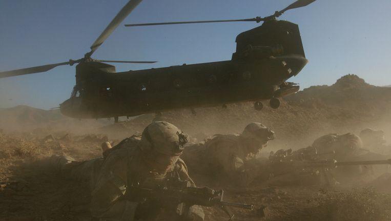 Amerikaanse soldaten in Helmand, Afghanistan, in 2006. Beeld AP