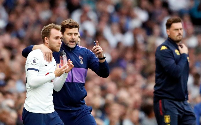 Tottenham-manager Mauricio Pochettino en Christian Eriksen, die deze transferperiode werd gelinkt aan Real Madrid.