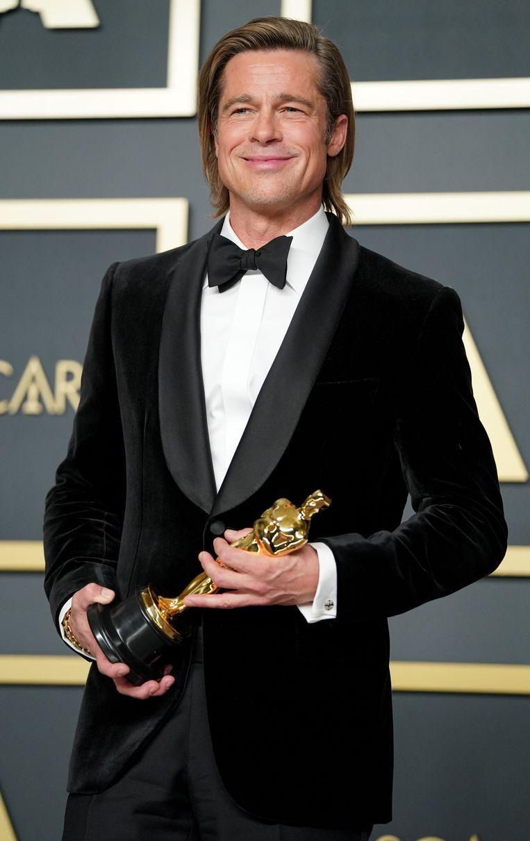 Brad Pitt wint een oscar voor zijn bijrol in Once Upon a Time in Hollywood.  Beeld AFP