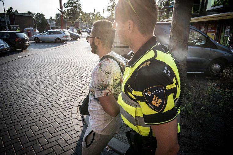 Aanhouding in de wijk Poelenburg in Zaandam. Beeld anp