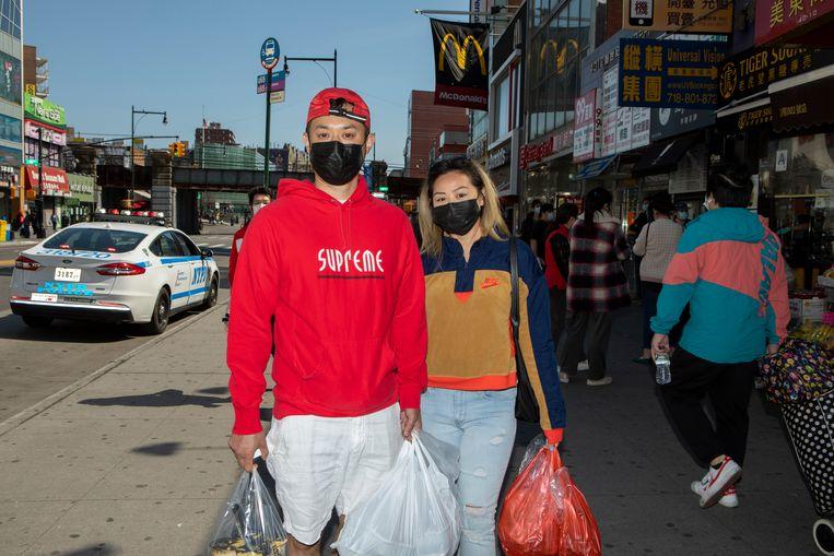 Perry Tran en Sophath Tin in Main street, de hoofdstraat van Chinatown in Flushing Queens. Beeld Chantal Heijnen