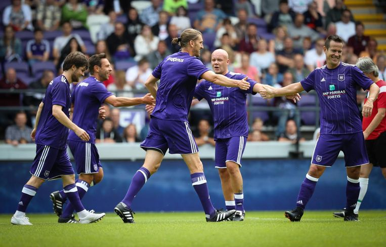 Anderlecht's assistant coach Nicolas Frutos and Gilles De Bilde celebrate after scoring during during a derby Legends game between RSCA and RWDM at the fan day of soccer team RSC Anderlecht, Sunday 30 July 2017 in Anderlecht, Brussels. BELGA PHOTO VIRGINIE LEFOUR