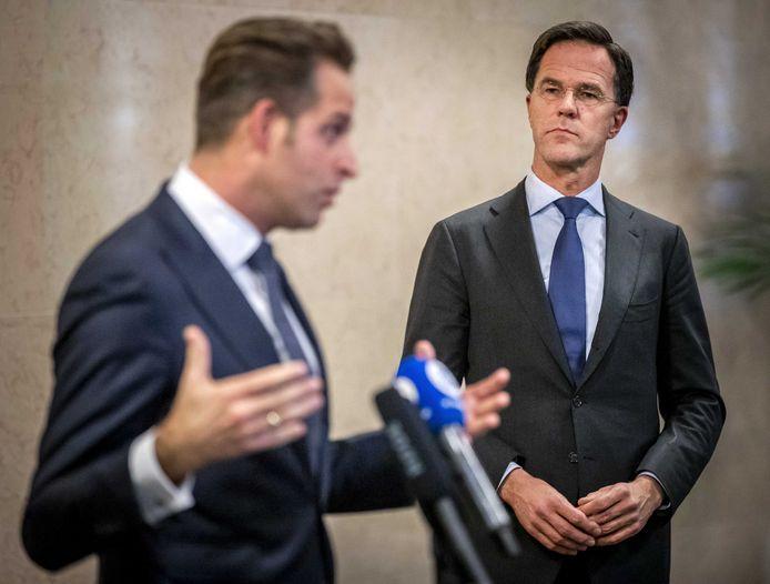 Minister Hugo de Jonge (L) en premier Mark Rutte