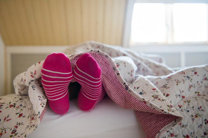 Sokken aan en het winterdekbed over je heen: het wordt vannacht koud. Foto ter illustratie