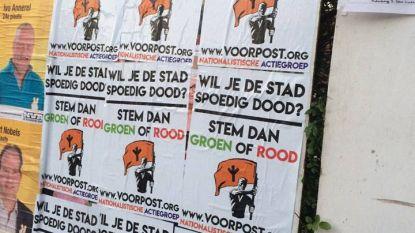Affiches sp.a-Groen overplakt door Voorpost