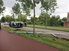 Auto belandt op kant bij botsing in Wijchen
