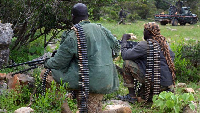 Somalische soldaten zijn op patrouille in een gebied ten noorden van hoofdstad Mogadishu. Beeld reuters