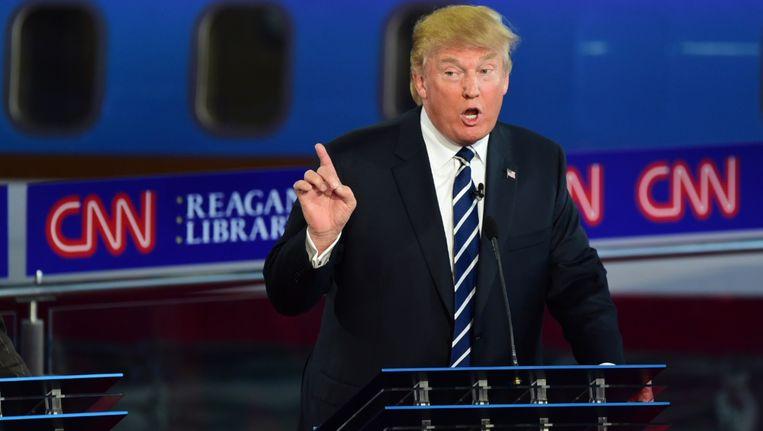 Donald Trump tijdens het debat. Beeld afp