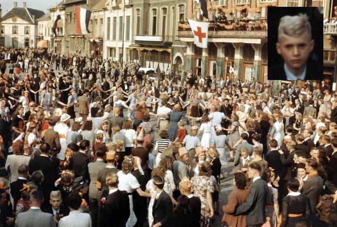 De dansende menigte op de Markt in Eindhoven, tijdens het bevrijdingsfeest op 18 september 1944. Herkent u het jongetje links voor op de foto, uitvergroot op de inzet?