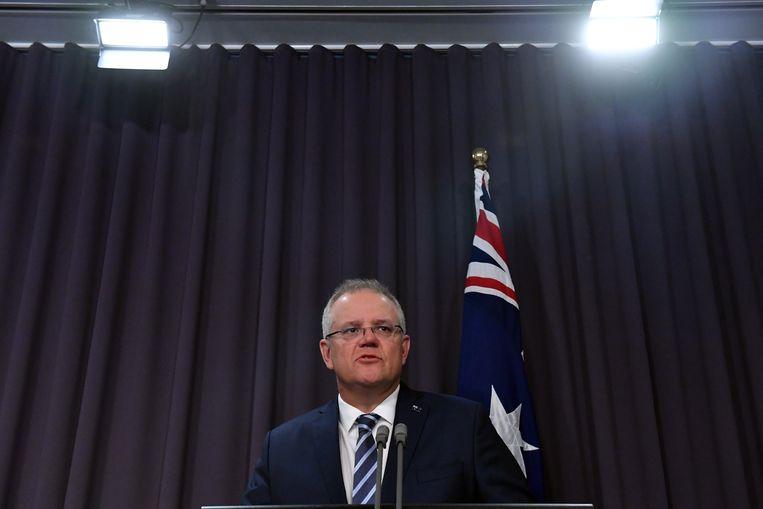 De Australische premier Scott Morrison tijdens de persconferentie. Beeld EPA