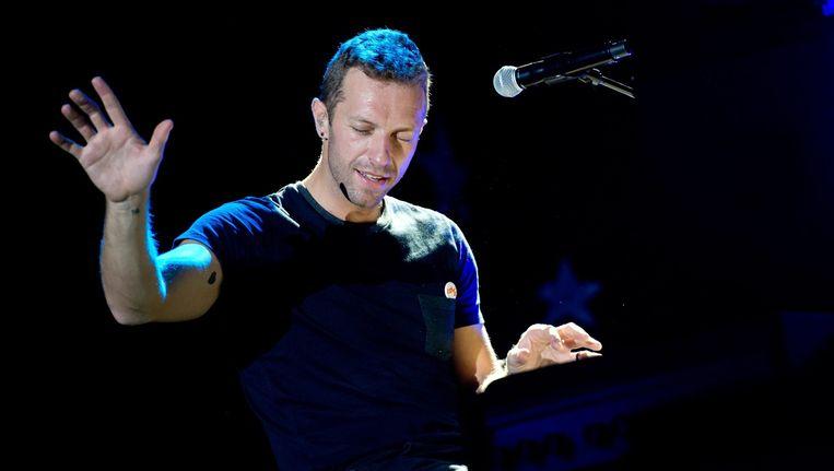 Frontman Chris Martin van Coldplay tijdens een optreden in 2014. Beeld epa