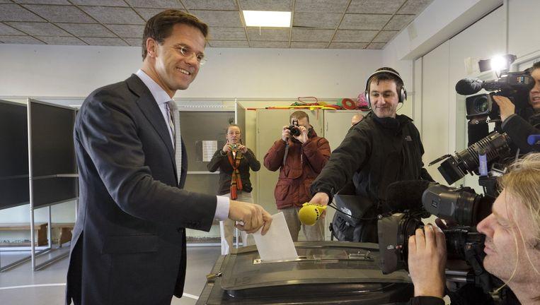 Premier Rutte stemt in Den Haag. Beeld null