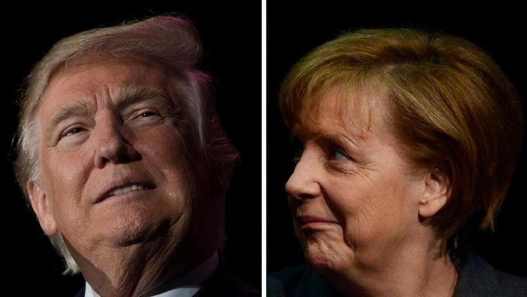 Donald Trump en Angela Merkel. Beeld afp