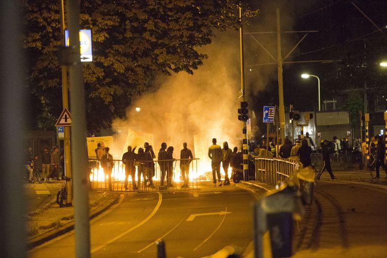 Rellen in de Haagse Schilderswijk na het overlijden van Henriquez. Beeld ANP